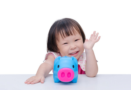 banco dinero: Asian girl smiling with piggy bank over white
