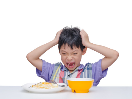 Asian child dont want to eat food for lunch