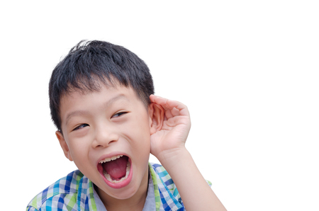 ear: Young Asian boy cupping hand behind ear on white background