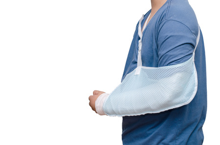 Asian boy with broken arm over white background