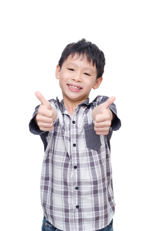Asian boy smile and showing thumbs up over white background Foto de archivo