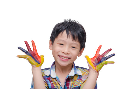 Little Asian boy with painted hands over white background Stock Photo