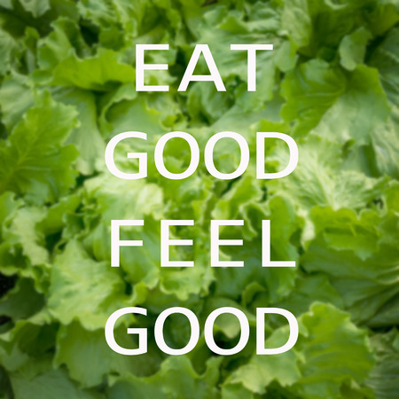 good food: Quote : Eat good feel good on vegetable background Stock Photo