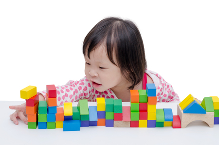 wood blocks: Little girl playing colorful wood blocks