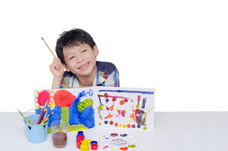 asian art: Young Asian boy painting art over white background