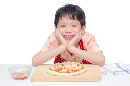 Little chef cooking pizza