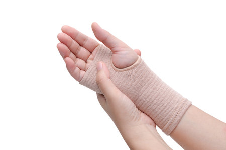 carpal tunnel syndrome: Hand with bandage support isolated over white