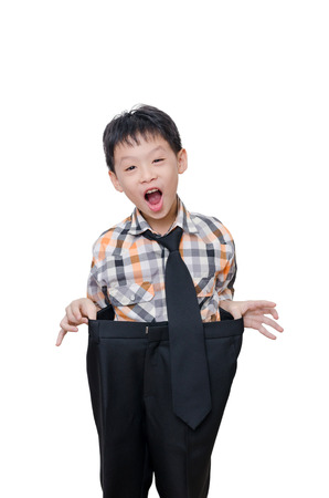 funny boy: Little Asian boy in big pants over white
