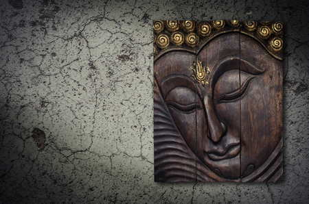 buddha face: Buddha image in Thai style wood graving on the wall Stock Photo