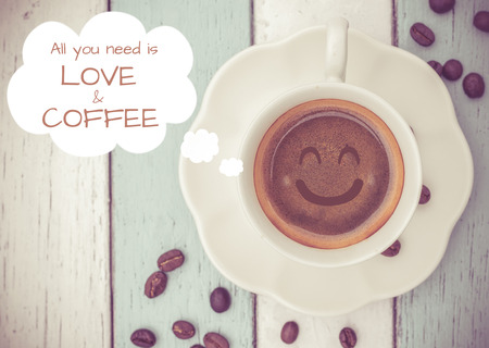 All you need ia love and coffee with coffee cup on table Stock Photo