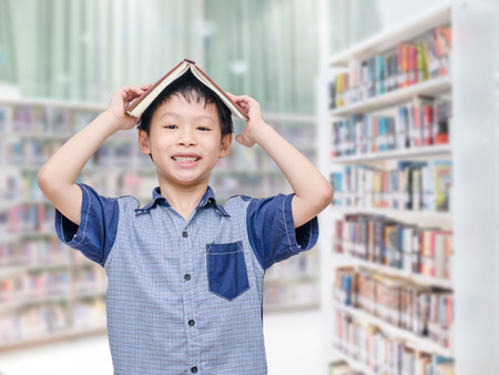 Young Asian boy in library