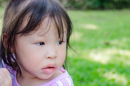 come home: Little Asian girl waiting for her parent come home Stock Photo