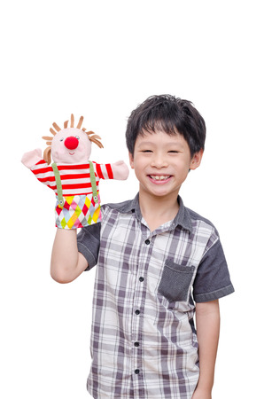 Young Asian boy playing with puppet