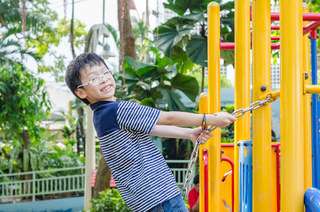 climbing frames: Young asian boy playing in playground