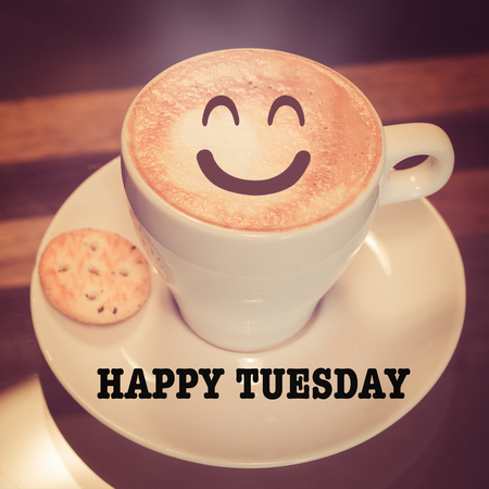 Happy Tuesday with coffee cup on table