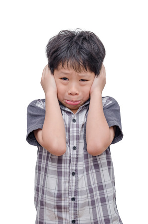 hands over ears: Young Asian boy close his ears by hands over white