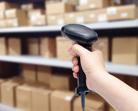 barcode: barcode scanner in womans hand isolated on white background Stock Photo