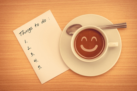 things to do: Things To Do List on paper with coffee cup Stock Photo