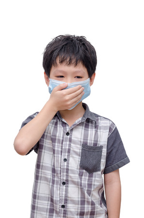 japanese children: Young Asian boy wearing mask over white background