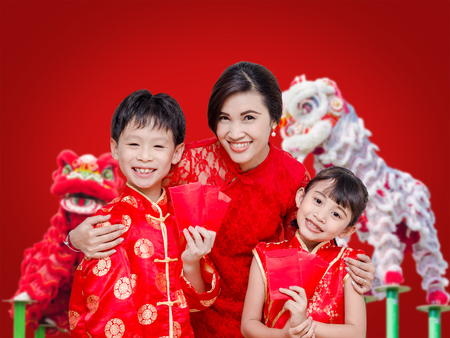 Asian family in chinese traditional dress holding red packet money