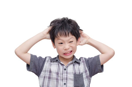 Young Asian boy scratching his scalp over white Stock Photo - 54724811