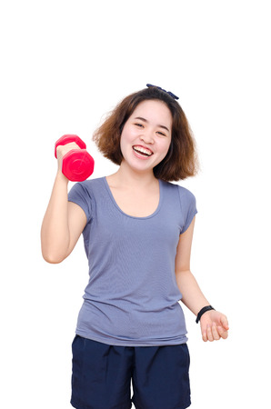 Young Asian girl smiling between exercising over white Stock Photo