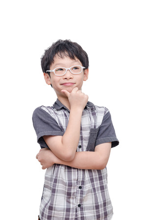 young boy smiling: Asian boy thinking over white background Stock Photo