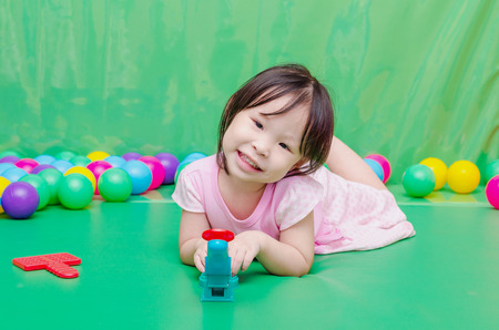 playschool: Little Asian girl playing toy at school