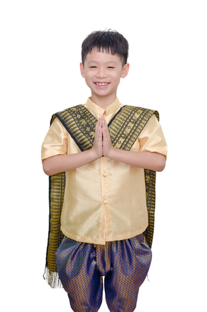 thai culture: Young boy in Thai traditional dress smiling and do gesture welcome