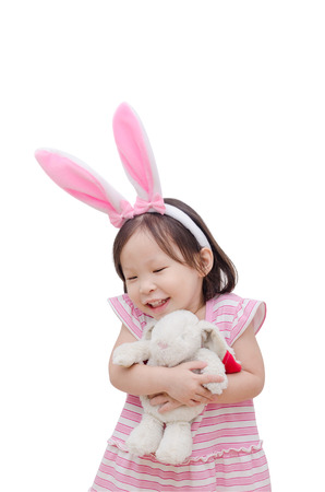 asian bunny: Little Asian girl with bunny ears over white