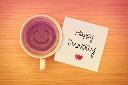 Happy Sunday on paper note with coffee cup,top view. Stock Photo