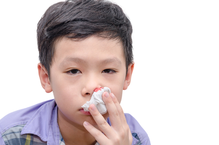 Young Asian boy wipe blood from his nose by tissue paper