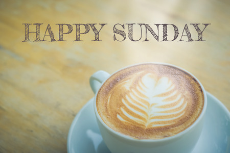 hedonism: Happy Sunday with coffee cup on table