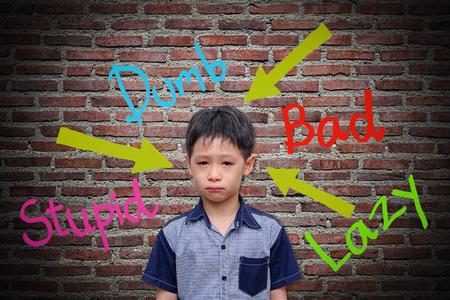 Abusive words hurt on the wall Foto de archivo
