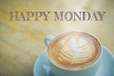 hedonism: Happy Monday with coffee cup on table