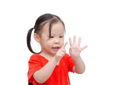 Little asian girl counting her finger over white Stock Photo