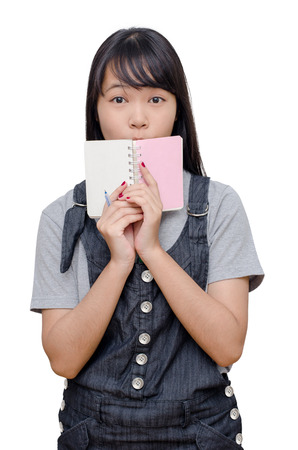Young asian girl reading book over white Stock Photo