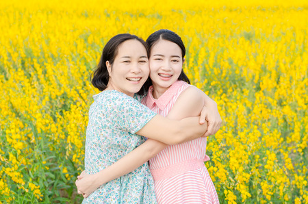 Asian mother and her daughter at flower field