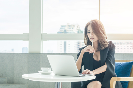 working office: Beautiful businesswoman working at office Stock Photo