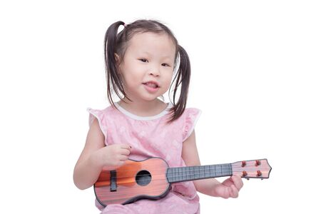 thai musical instrument: Little asian girl playing guitar toy over white
