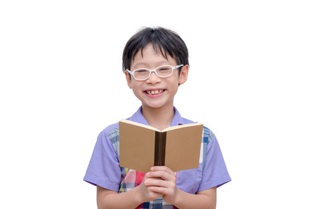 Asian boy reading a book on a white background