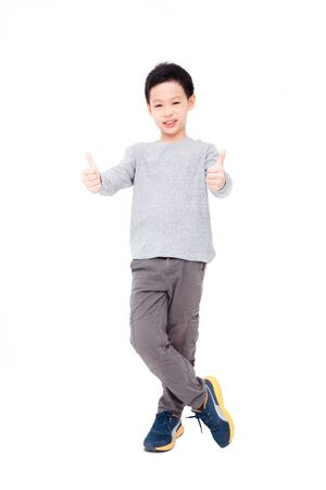 white: Young asian boy standing over white background