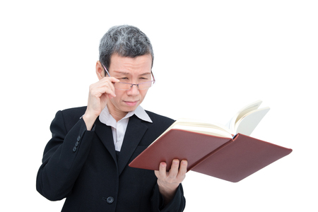 Senior businesswoman reading book