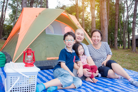 Asian Family at camping site Stock Photo