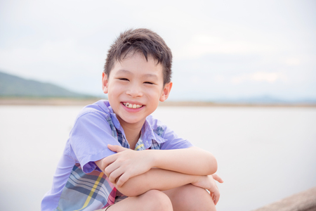 Young asian boy smiling at camera Stock Photo