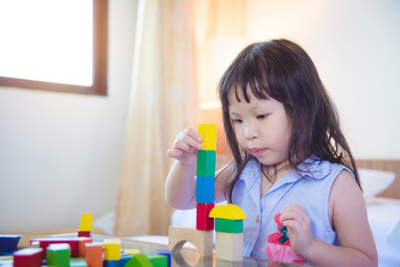 Little asian girl playing block at home Stock Photo