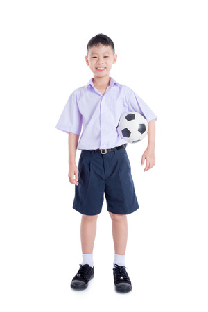 Young asian schoolboy over white