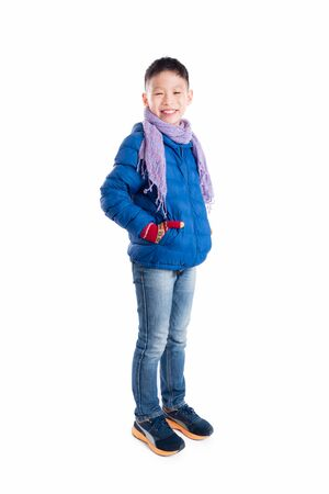 winter fashion: Asian boy in jacket over white background