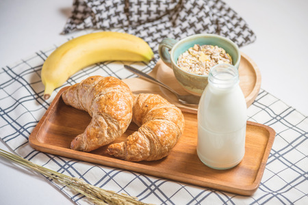 Cereal,bread ,milk and banana on table Stock Photo
