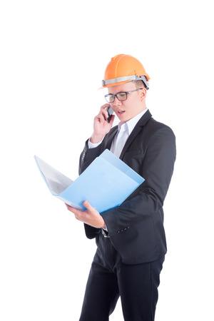 Engineer man talking via mobile phone over white